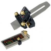 Hulpstuk en meetinstrument voor het slijpen van beitels.